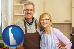 Delaware - a senior couple standing in their apartment kitchen