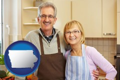 Iowa - a senior couple standing in their apartment kitchen