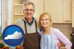 Kentucky - a senior couple standing in their apartment kitchen