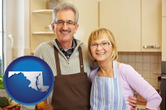 maryland map icon and a senior couple standing in their apartment kitchen