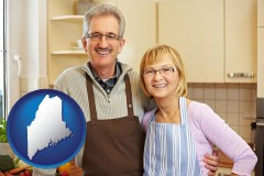 maine map icon and a senior couple standing in their apartment kitchen