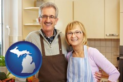 Michigan - a senior couple standing in their apartment kitchen