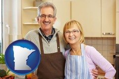 Minnesota - a senior couple standing in their apartment kitchen