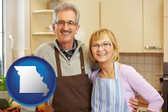 Missouri - a senior couple standing in their apartment kitchen
