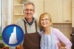 new-hampshire map icon and a senior couple standing in their apartment kitchen