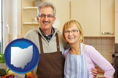 ohio map icon and a senior couple standing in their apartment kitchen