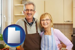 utah map icon and a senior couple standing in their apartment kitchen