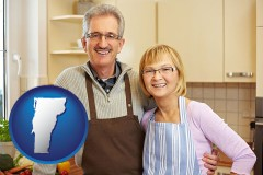 vermont map icon and a senior couple standing in their apartment kitchen