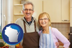 Wisconsin - a senior couple standing in their apartment kitchen