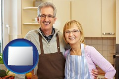 wyoming map icon and a senior couple standing in their apartment kitchen