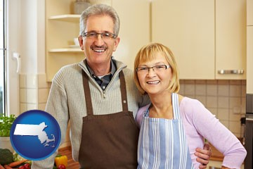 a senior couple standing in their apartment kitchen - with Massachusetts icon
