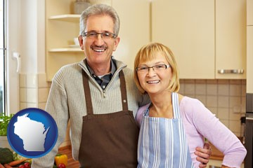 a senior couple standing in their apartment kitchen - with Wisconsin icon